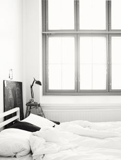 White walls and trim with grey windows