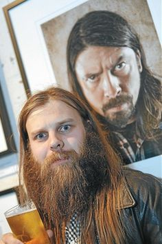 local melbs photographer kane hibberd with dave foofighters grohl in the background, also rather jesus like.