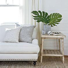 coastal rug, side table, sofa, leaves