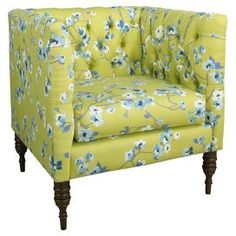 """Add a glamorous touch to your living room seating group or master suite ensemble with this pine wood-framed arm chair, showcasing floral-print upholstery and foam cushioning. Handmade in the USA.  Product: ChairConstruction Material: Pine wood, foam and cottonColor: GreenFeatures: Handmade in the USADimensions: 33"""" H x 33"""" W x 28"""" D"""