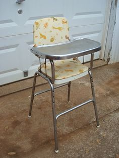 high chair in the early '60s. ~ everyone had these :)