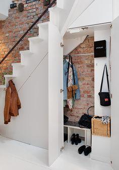 Under stairs at Lyla - coat closet?