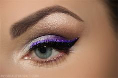 purple shimmer smokey eye with purple & black liners for a show-stopping party look <3