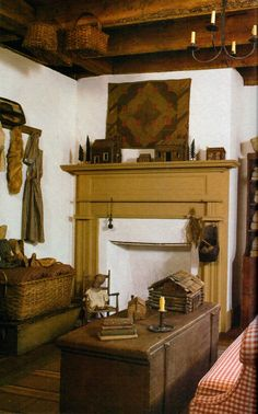 Primitive Gathering...of needfuls...mini log cabins on the mantel and the stacked boxes & old basket.