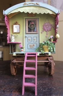 Gypsy Caravan by Lu:this looks like a playhouse version to me. I can imagine a little girl's joy if she could have naptime in there.