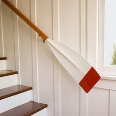 A love of all things nautical prompted this homeowner to transform an old oak oar into a sea-worthy staircase railing. | Photo: Mark Lohman | thisoldhouse.com