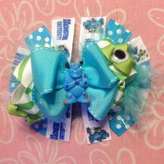 Monsters University Monsters Inc Sulley and Mike Hair Bow. $10.50, via Etsy.