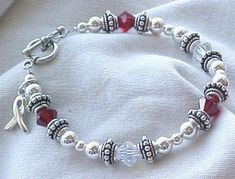 """Juvenile Diabetes Awareness Bracelet...""""red signifies the blood drops needed for testing each day and clear is for the teardrops shed"""". 42$."""