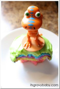 maybe do a rainbow cake instead of the cupcakes, and then top with buddy & tiny (or whoever i can find)