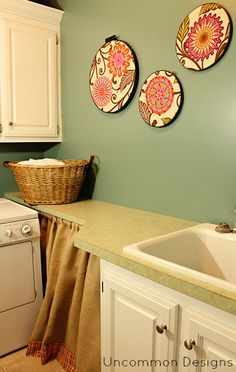 laundry room art - fabric and embroidery hoops - what a fun idea with so much potential!
