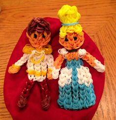 CINDERELLA and her PRINCE. Designed and loomed by Donna Lorber on the Rainbow Loom. Rainbow Loom FB page.