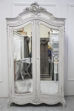 Armoire- love the mirrors