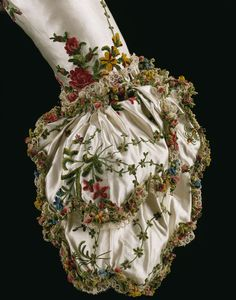 ~Fashion ball gown dress 18th Century Mantua from 1775-1785 made in Great Britain, United Kingdom woven in France. Hand woven and hand sewn, the tangled garden of chenille decoration on silk satin embroidered with coloured silk chenille thread, and   garland trim and linen, in a meandering pattern of flowers and leaves. A fly fringe braid of chenille threads, wound into the shapes of more flowers and leaves with bobbin lace fringe decorated the mantua,   sleeve and neckline~