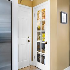 This former coat closet became a pantry just steps from the fridge | Photo: Ryan Kurtz