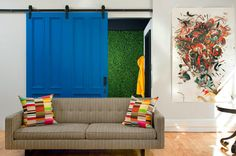 I like the big sliding door and the splash of color.  Would be awesome in a big loft with exposed brick.