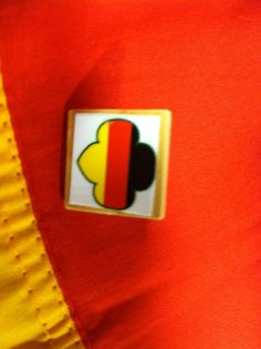 We made this pin for World Thinking Day. The country our troop was representing was Germany. It is the German flag in the Girl Scout trefoil shape mounted on a wooden Scrabble game piece with pin glued on the back.