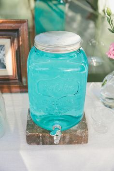 jumbo-sized mason jars as drink dispensers, photo by Onelove Photography http://ruffledblog.com/1920s-inspired-ace-hotel-wedding #aqua #weddingideas
