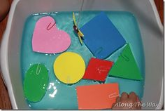 Lots of great ideas - including this cute fishing for shapes/colors game. The foam shapes float and are caught by the paperclip/magnet rod.   Preschool: colors, shapes, counting, outdoors, ocean, get-moving