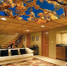 Ceiling Art,  Ceiling art fits easily into your dropped ceiling or suspended ceiling grid and provides not only easy access to pipes and wires overhead but creates a larger than life appearance for the overall space. 20  Cool Basement Ceiling Ideas, http://hative.com/cool-basement-ceiling-ideas/,
