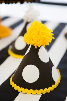 Cute homemade party hats at a yellow, black and polka dot hat party! #homemade #partyhats #polkadot #party