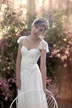 this wedding dress, so lovely! love the lace flutter sleeves