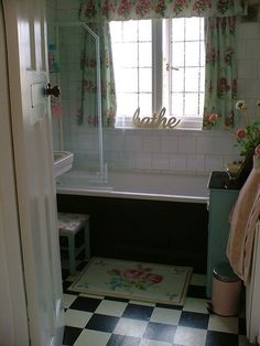 cute tiny cottage bath - love the black and white floor with the greens and pinks