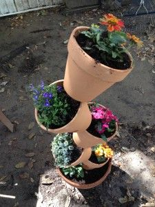 Garden Idea: Stacking Flower Pots for Spring! Perfect for an herb garden. I used 3/8 6foot piece of rebar. It fits perfectly into the holes in the bottom of the terracotta pots