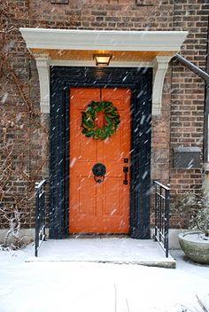 orange door w/ black and brick--- my perfect front door