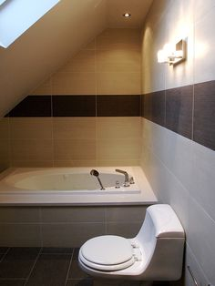 Attic small basement bathrooms on pinterest attic for Small bathroom with sloped ceiling