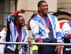 Happy to be there: Nicola Adams and Anthony Joshua smile as they wave at the crowds