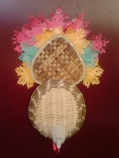 Thanksgiving Turkey door hanging - basket, bamboo fan, seed pot, paper leaf doilies, piece of red ribbon, googly eyes