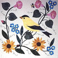 """Nature's Garden Collector Series: Common Goldfinch  Size: 18"""" x 18"""" finished block  Block features a common goldfinch, wild morning glories, true forget-me-nots, common sunflowers, a honey bee and a lady bug."""