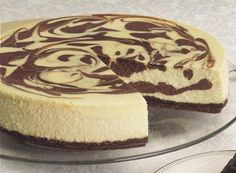 Give your traditional cheesecake a rest and enjoy this recipe for Deluxe Marbled Cheesecake, made with rich HERSHEY'S Cocoa.