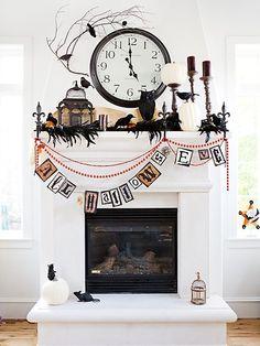 black & white Halloween mantle decor...use a black boa #halloweendecorating