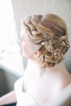 wedding hair with fabric flowers, photo by She Wanders Photography http://ruffledblog.com/del-mar-powerhouse-wedding #weddinghair #bridal