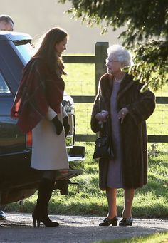 Queen Elizabeth II (R), and Catherine, Duchess of Cambridge (L) arrive at the Christmas Day service at Sandringham on 25.12.13 in King's Lynn, England.