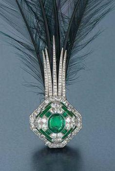Cartier emerald and diamond aigrette, circa 1925    http://vintagejewelryinformation.com/weekwords/images/emeraldcartier2.jpg