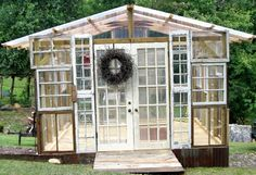 Greenhouse built from old windows collected over the years. By Kathy of Moss & Twigs, Asheville. mosstwigs.blogspot.com