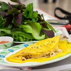 Bánh Xèo: Vietnamese savory crepes stuffed with shrimp and mushrooms