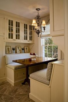 Pretty eating nook (with storage!) off kitchen in a Row house. Nice way to maximize space in a narrow kitchen. Have to consider this...