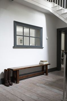 Love this. Love the wooden frame added to a large mirror to give the effect of a window and light.