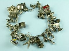 Charm bracelets, yesterday's Pandora bracelet!  Every girl had one one...its about 50 yrs old.  MID CENTURY CHARM...