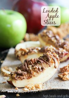 Peanut butter, granola, and chocolate atop a sweet slice of apple. #easy #snack #healthy http://www.highheelsandgrills.com/2014/02/loaded-apple-slices.html