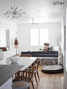 lovely dining room/ living room with great white shelves and sputnik style light