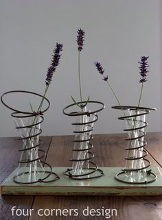 Mattress springs as vases; four corners design