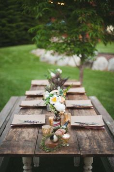 Transform a rustic farm-style table with wildflower bouquets and votive candles.