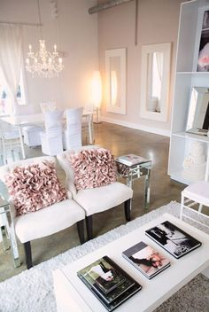 Chairs and pink pillows