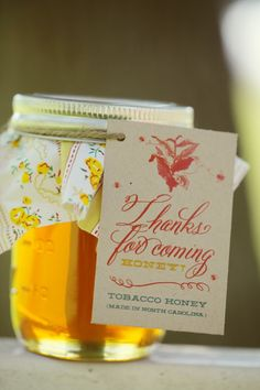 A locally produced honey adorned with a personalized message from the bridge and groom make the perfect wedding keepsake to send home with guests.