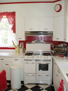 cute red, white and black kitchen