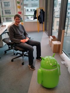 Daniel Waisberg posted a picture on Google+ of his co-worker Yonatan Matalon controlling a large Android figurine at the Google London office.  This is a large remote control Android that can walk aro